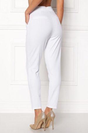 Vita kostymbyxor